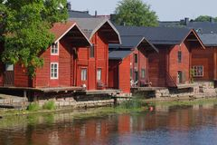 Old wooden barns on the river bank close up, July afternoon. Porvoo, Finland. Old wooden barns on the river bank close up on a sunny July afternoon. Porvoo stock images