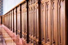 Old wooden baroque furniture wall with bokeh stock photography