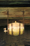 Old wooden barrel. Hanging by two iron chains royalty free stock images