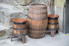 Old wooden barrel. Old wooden barrel that acts as a coffee table and two basins that serve as chairs stock photo