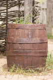 Old wooden barrel adapted as a bed Stock Image