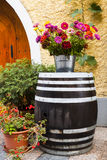Old wooden barrel and beautiful colorful flowers Royalty Free Stock Images
