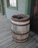 Old wooden barrel. On wooden floor outside a door stock images