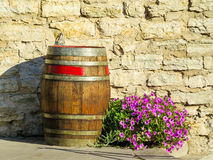 Old wooden barrel and flowers stock images