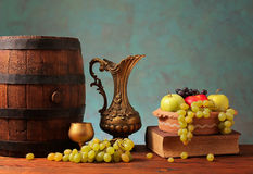 Old wooden barrel and fruits Royalty Free Stock Photos