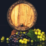 Old wooden barrel and grapes. Royalty Free Stock Photos