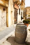 Old wooden barrel on narrow street Mdina, Malta Stock Photography