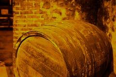Old wooden barrel in wine cellar Stock Photo