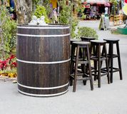 Old wooden barrel with wood stool bar Stock Photos