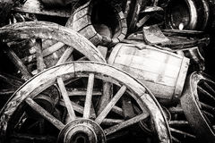Old wooden barrels and broken wheels Royalty Free Stock Photos
