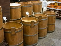 Old wooden barrels with corn, rice and buckwheat in market place royalty free stock photos