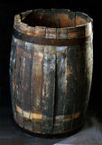 Old wooden barrels on a dark background Stock Photo