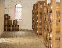 Old wooden barrels. Old wooden gunpowder barrels in a cellar Stock Photography