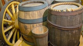 Old wooden barrels with metal hoops closeup on wagon. stock photos