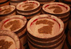 Old wooden barrels. Romanian good luck word on the cover. Stock Photos