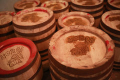 Old wooden barrels. Romanian good luck word on the cover. Royalty Free Stock Photography