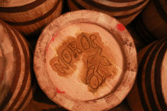Old wooden barrels. Romanian good luck word on the cover. Royalty Free Stock Image