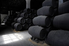 Old wooden barrels of sherry in bodega. Of Spanish town of Jerez de la Frontera Stock Photo