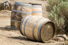 Old Wooden Barrels. Old wooden storage barrels lay discarded outside on the ground Royalty Free Stock Photography