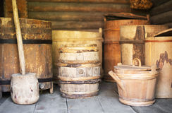 Old wooden barrels. Storage racks with old wooden barrels Stock Images