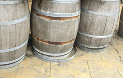 Old wooden barrels and tanks for processing wine. Oak Stock Photography