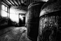 Old wooden barrels - 1891. A very old barrels inside an abandoned countryhouse Stock Photography