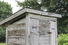 Old wooden bathroom in the field Royalty Free Stock Photography