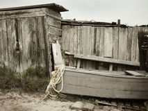 Old wooden beach warehouse and boat Royalty Free Stock Images