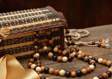 Old wooden beads, wooden casket and hairbrush on table Stock Photography