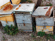 Old Wooden Beehives. Three old and disused wooden beehives stock photography