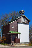Old wooden belfry and blue sky Stock Image