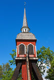 Old wooden belfry at the blue sky. Old wooden belfry in summer Royalty Free Stock Photography