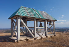 Old wooden belltower. Russia. White mountain Stock Photo