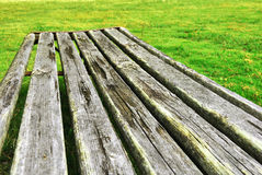 Old wooden bench. The Old wooden bench on green grass Royalty Free Stock Photo