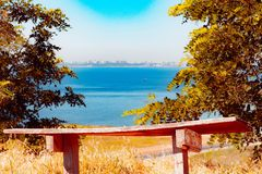 An old wooden bench on the beach. royalty free stock photo