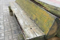 Old wooden bench in the brutal style.  Stock Photos