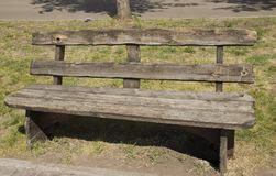 Old wooden bench in the city Park royalty free stock images