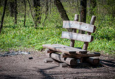 Old wooden bench in the forest Stock Photography
