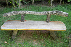 Old wooden bench in the garden Royalty Free Stock Photo