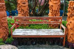 Old wooden bench in the garden Stock Image