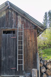 Old wooden bench ladder against the wall Stock Photos
