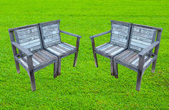 Old wooden bench on lawn Royalty Free Stock Photos