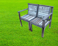 Old wooden bench on lawn Royalty Free Stock Photography