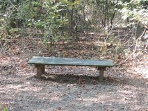 Old Wooden Bench on a hiking trail Stock Photos