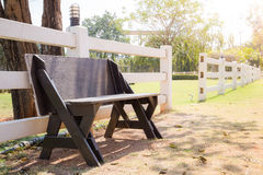 Old wooden bench in park Stock Photo