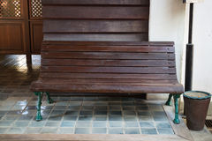Old wooden bench in public train station Stock Photography