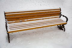 Wooden bench in the snow Stock Images