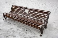 Wooden bench in the snow Royalty Free Stock Images