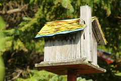 Old wooden bird house Stock Images