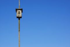 Old wooden bird house and blue sky background Royalty Free Stock Image